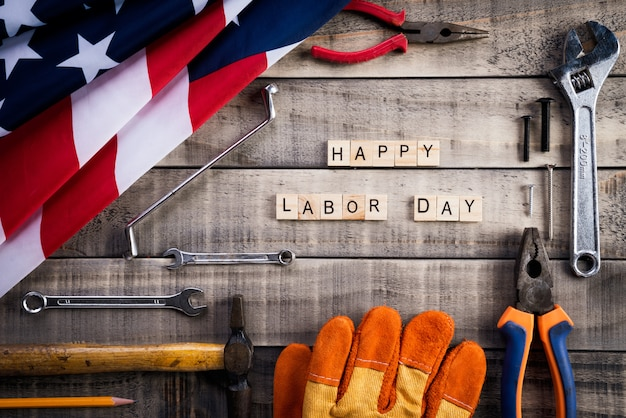 Labor day, usa america flag with many handy tools on wooden background