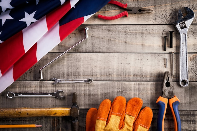 Labor day, usa america flag with many handy tools on wooden