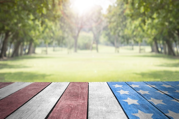 Labor day usa flag on table top in the park for background