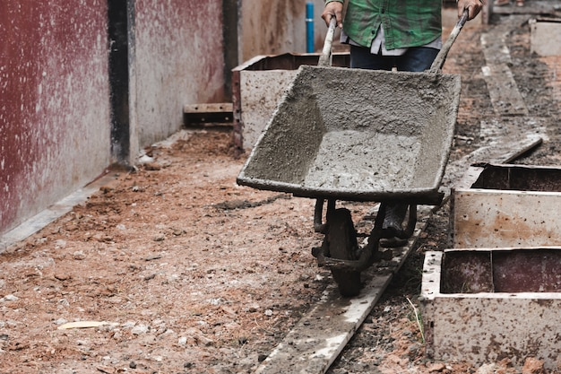 Labor work concrete with cart