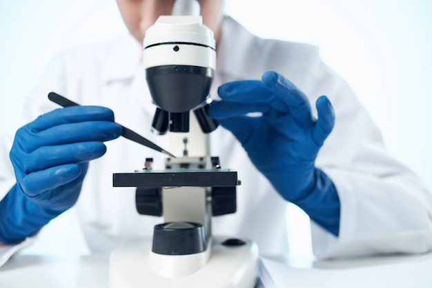 Laboratory assistant chemical solutions biologist research study light background