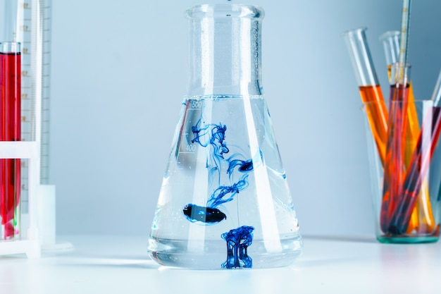 Laboratory flask glassware with reflections on table close up