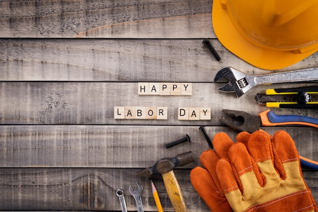 Labour day, wooden block calendar with many handy tools on wooden