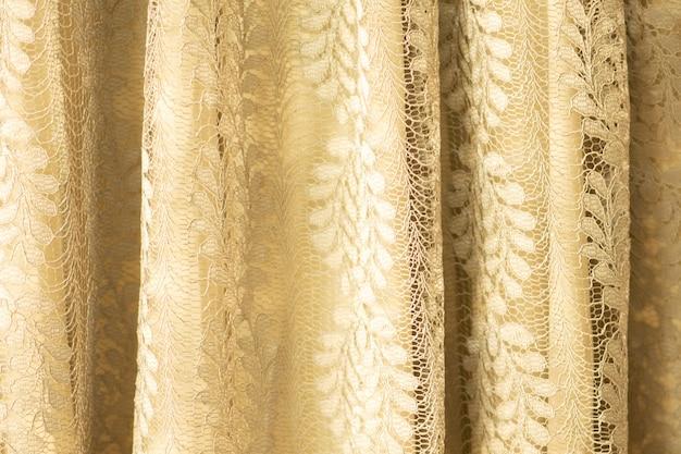 Lace fabric background, yellow lace fabric