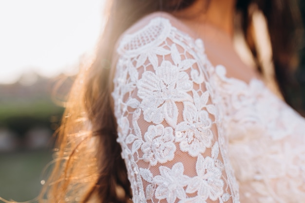 Laced white sleeve of the wedding dress