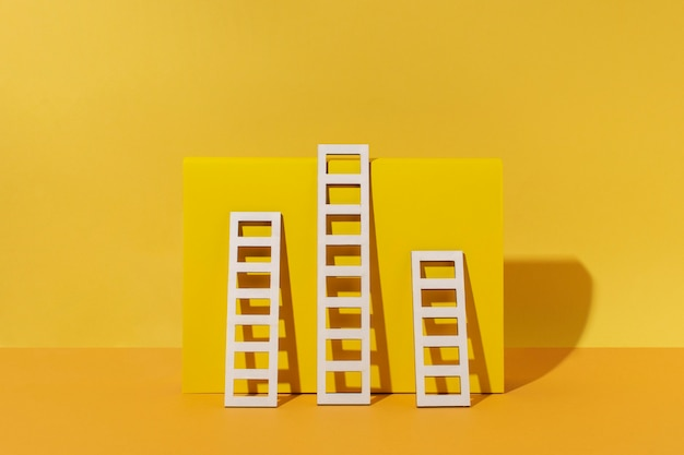 Ladders arrangement with yellow background