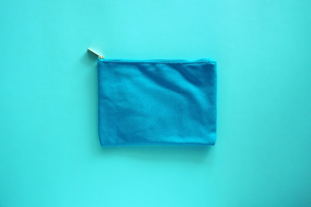Lady fabric bag on blue for cosmetics and beauty concept