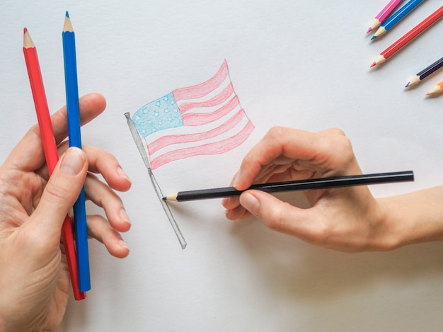 Lady painting the flag of the united states of america.