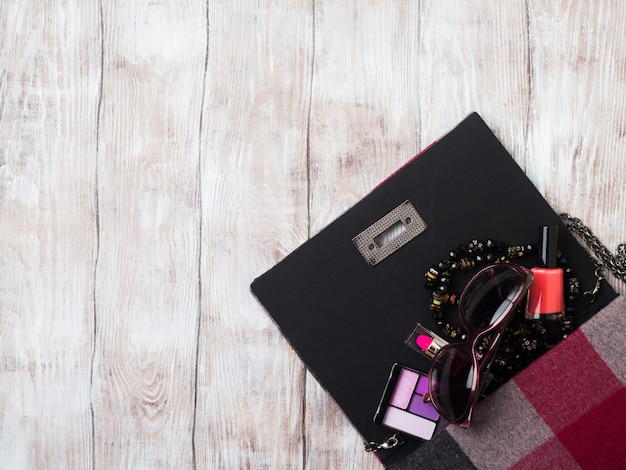 Lady's clutch bag with make up accessories