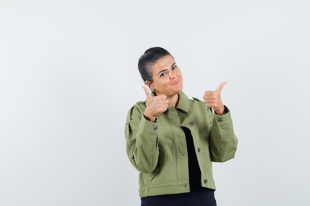 Lady showing double thumbs up in jacket
