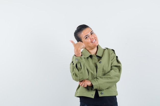Lady showing thumb up in jacket