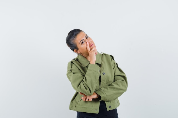 Lady standing in thinking pose in jacket
