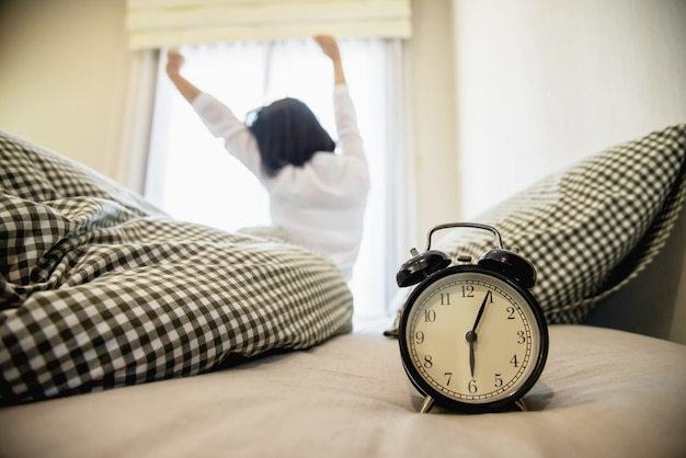 Lady wake up stretch oneself lazily for fresh morning