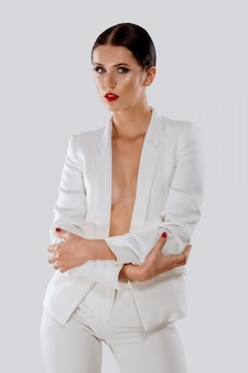 Lady in white pantsuit