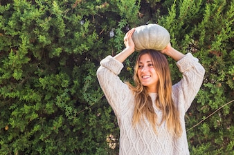 Lady with pumpkin on head