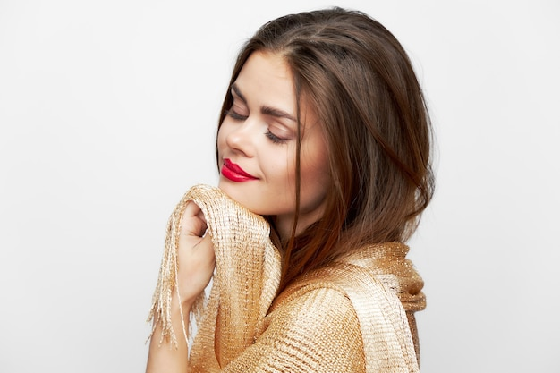 A lady with a shawl with closed eyes smile hands near face fashionable style
