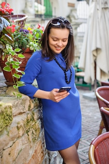Lady with a surprised expression on her face looking to smartphone