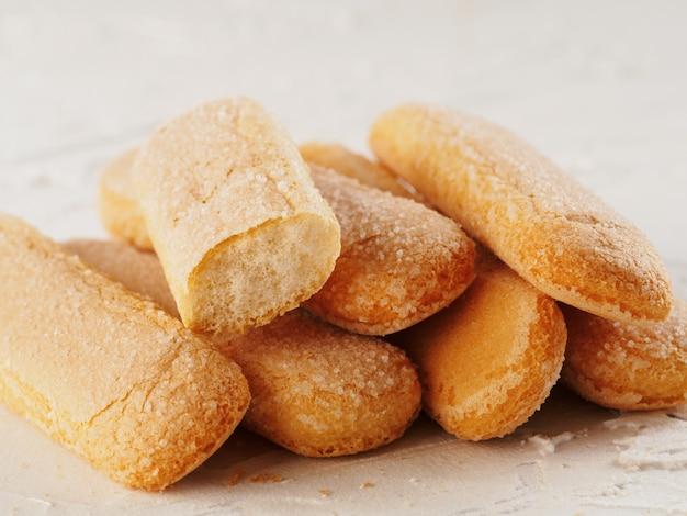 Печенье печенья ladyfinger savoiardi крупным планом