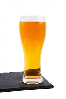 Lager beer in glass on white background