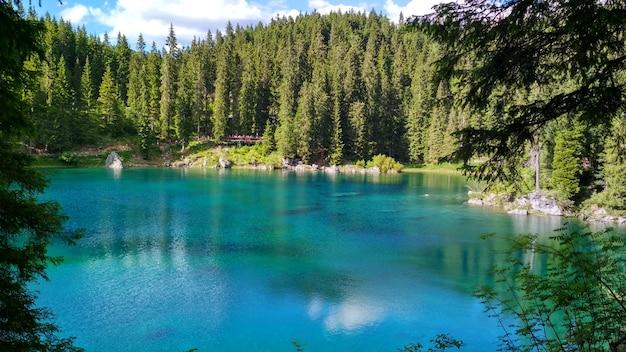 Lago di carezza (karersee), a beautiful lake in the dolomites, trentino alto adige, italy