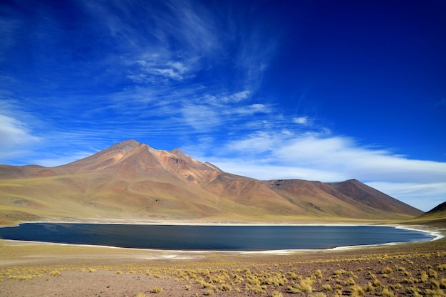 Laguna miniques or miniques lake with cerro miscanti volcano at the highland of northern chile