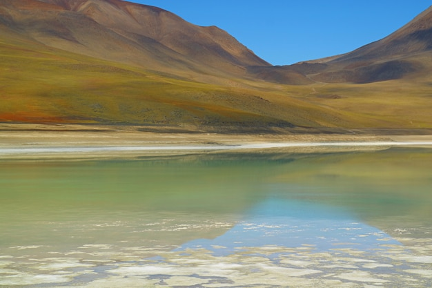 Laguna verde or the green lake with the reflection of lincancabur volcano, bolivia