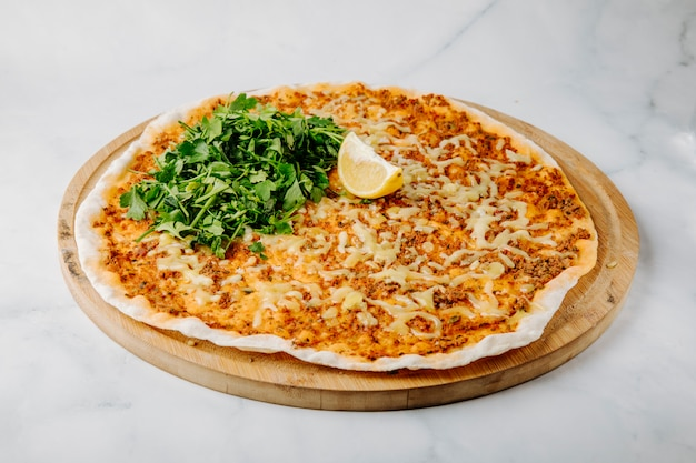 Lahmacun on lavash with lemon and parsley.