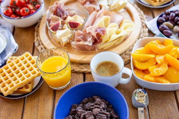 Laid table with foodbreakfast with coffee and juiceorange juice with coffee for breakfast buffet