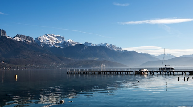 Lake annecy in autumn under a blue sky