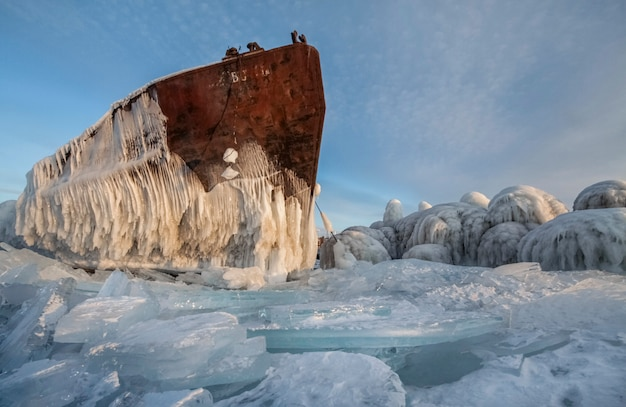 Lake baikal is covered with ice and snow, strong cold, thick clear blue ice