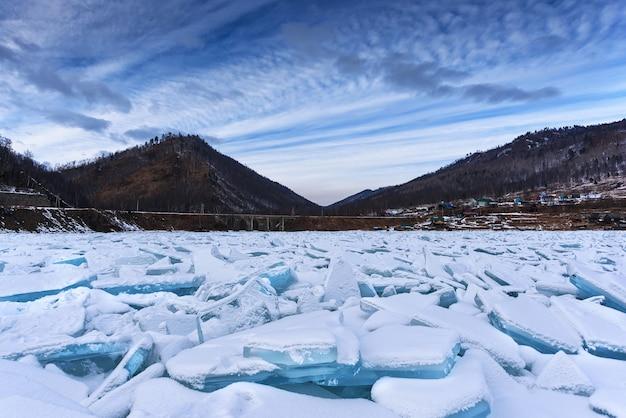 Lake baikal in siberia with a pile of beautiful ice hummocks near the old circum baikal railway in winter