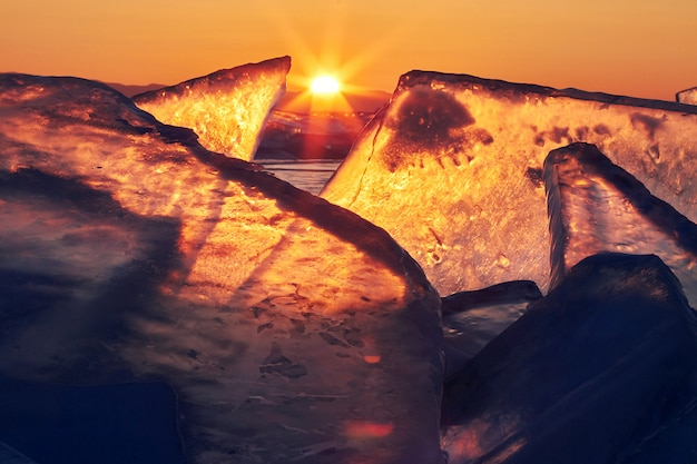 Lake baikal at sunset, everything is covered ice