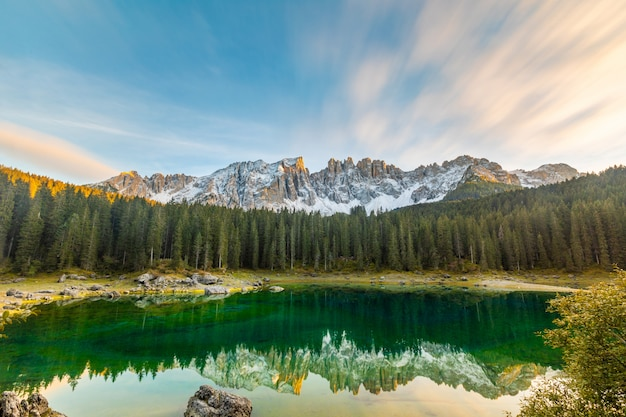Lake carezza or karersee at sunset background