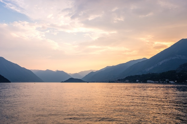 Lake como with mountains at sunset