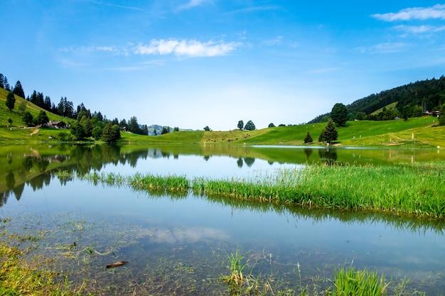 Lake of the confins and mountain landscape in la clusaz, haute-savoie, france