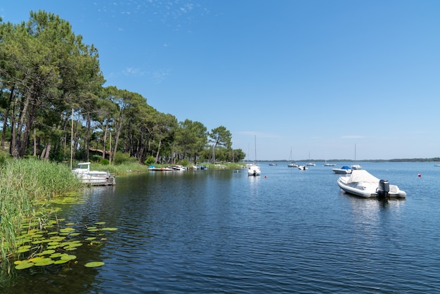 Lake in gironde france in lacanau village with boat