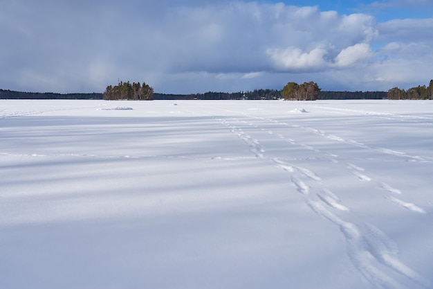The lake is covered with ice and snow in littoinen, finland.