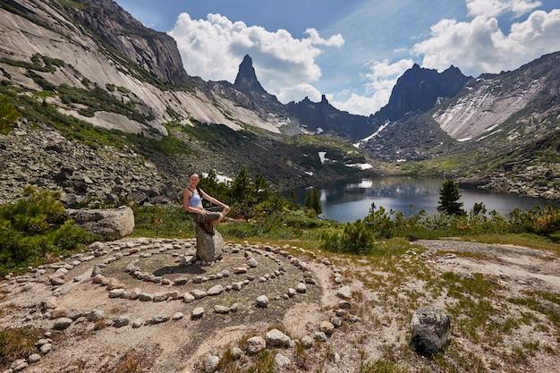 Lake of mountain spirits, woman sitting on stone