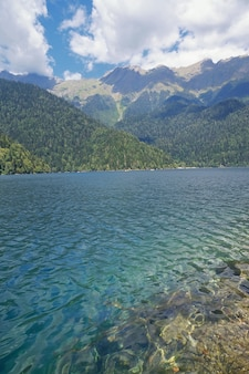 Lake ritsa in mountains in abkhazia in a summer sunny day.