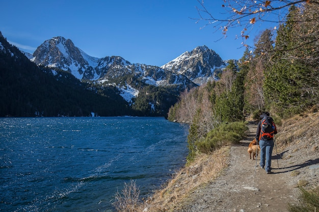 Lake of sant maurici, trekking dog and woman