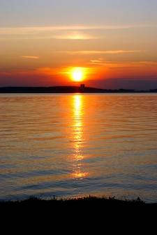 Lake at sunset background