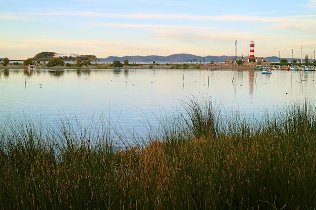Lake titicaca with puno cruise ship port, puno town, peru