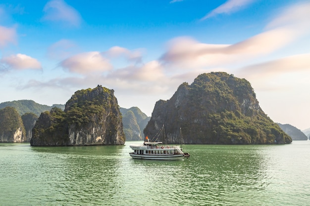 Lake with big mountains, a boat and blue sky with clouds in thailand