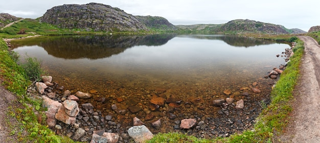 Lake with clean, fresh water on the shore of the barents sea. kola peninsula , russia.