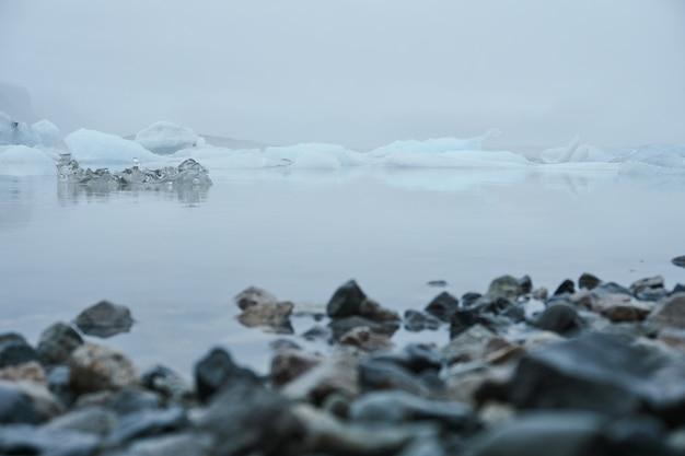 Lake with ice and fog. jokulsarlon glacial lake