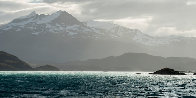 Lake with mountain range in the background, torres del paine national park, patagonia, chile