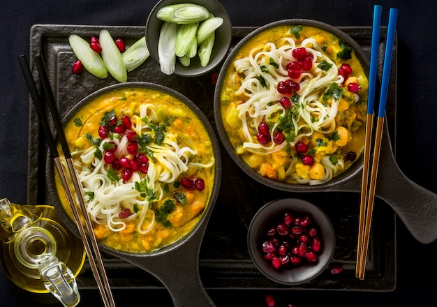 Laksa with pumpkin and coconut milk, rice noodles, broccoli and pomegranate seeds