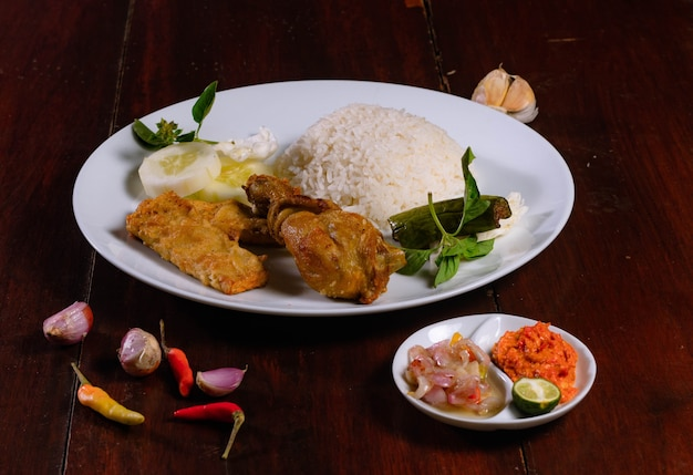 Lalapan chicken with spicy chili sauce and fresh vegetables