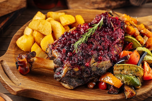 Lamb knuckle with lingonberry sauce and vegetables