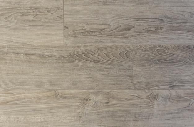 라미네이트 배경. 인테리어 디자인의 바닥 용 목재 라미네이트 및 쪽모이 세공 보드. 천연 나무의 질감과 패턴